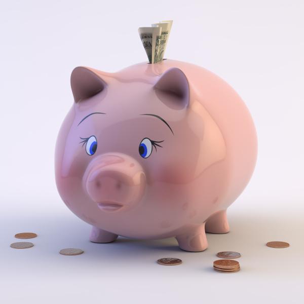 piggy bank con monete e bollette