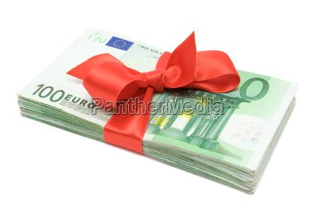 mazzetta di soldi con larco rosso