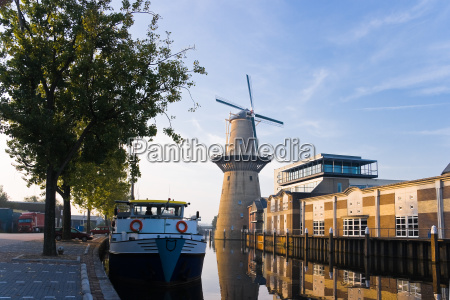mill and ship with reflection at