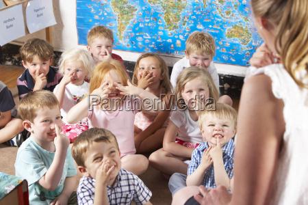 montessori pre school class listening al