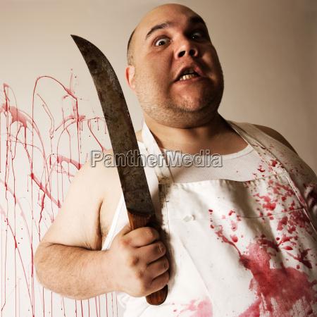 macellaio pazzo con coltello