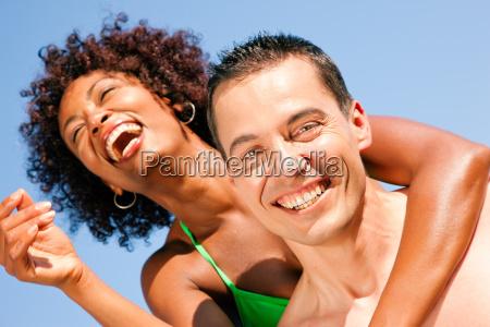 couple embrace on the beach