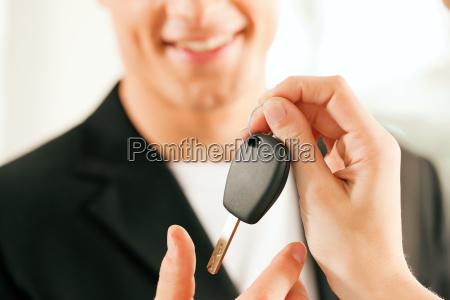 man buying a car keys
