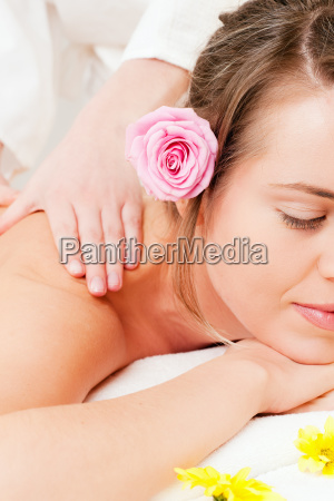 woman in the spa gets massage