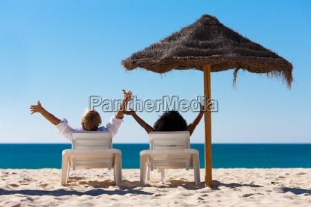 couple on the beach on holiday