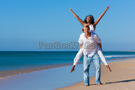 couple on the beach on vacation