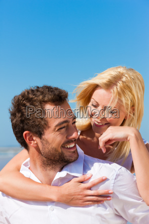 couple sand and beach in summer