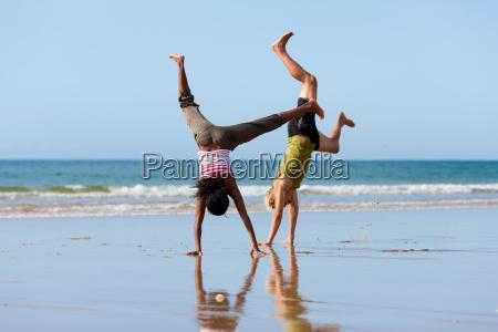 sporty couple doing gymnastics on the