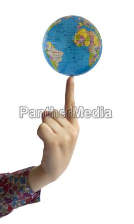hand holding globe on finger