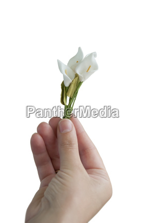 hand gives small bouquet flowers