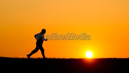 tramonto silhouette sport jogging rotore cielo