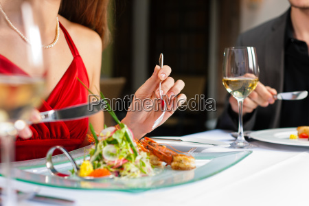 couple eating and drinking in a