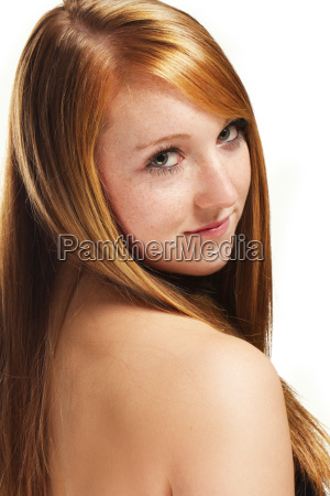 young red haired woman looks over