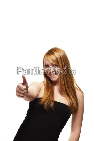 young red haired woman with thumb
