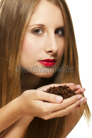 beautiful woman smelling coffee beans