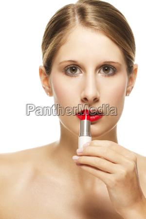 young beautiful woman wearing lipstick on