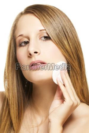 young beautiful woman during abschminken