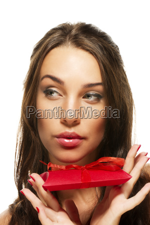 beautiful woman holds gift and looks