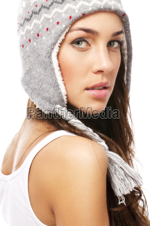 beautiful woman with winter cap looks