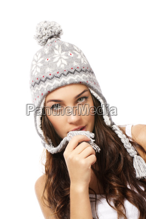 beautiful woman playing with her wintermuetze