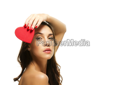 beautiful woman holding red heart over