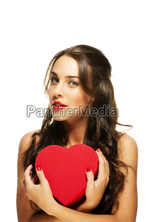 beautiful woman holding red heart