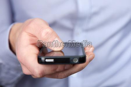 telefono dito uomo daffari businessman schermo