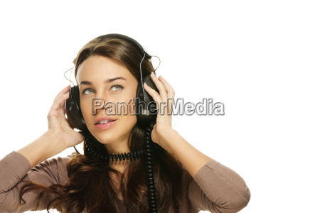 young woman listening to music and