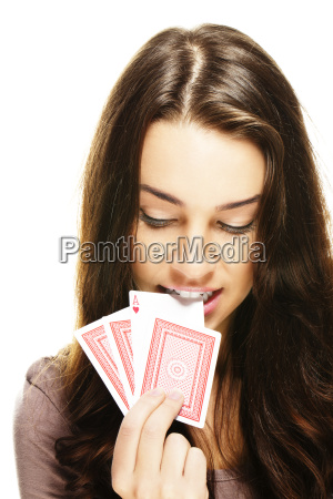 young woman pulls a poker card