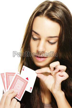 young beautiful woman chooses a poker
