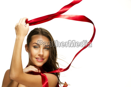 happy woman playing with red tape