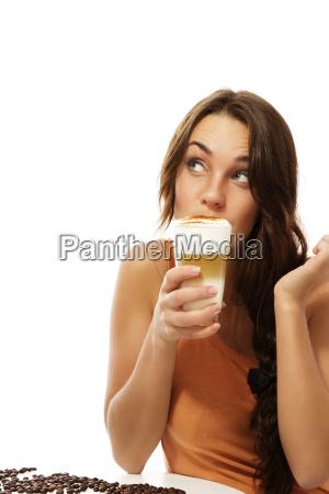 young woman drinking latte macchiato coffee