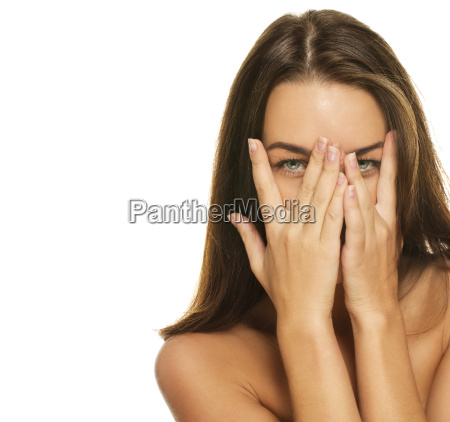 beautiful woman covered her face with