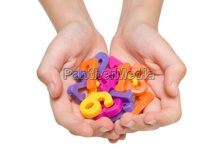 hands holding plastic numbers