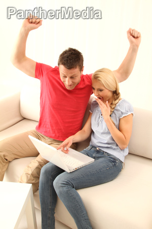 couple working at home on laptop