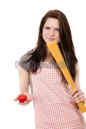 young woman with spaghetti and tomato