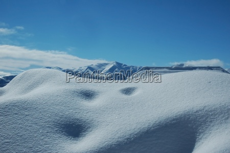 snowdrift and clear blue sky