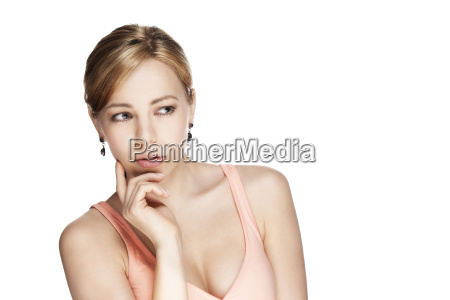 thoughtful young beautiful blond woman looking