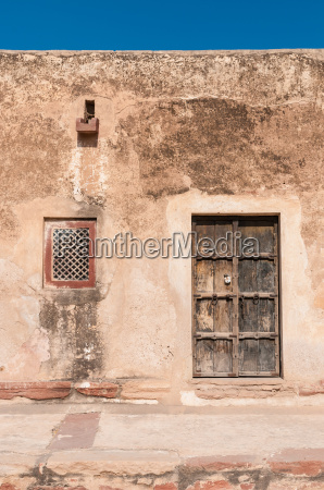 residential building with wooden doors and