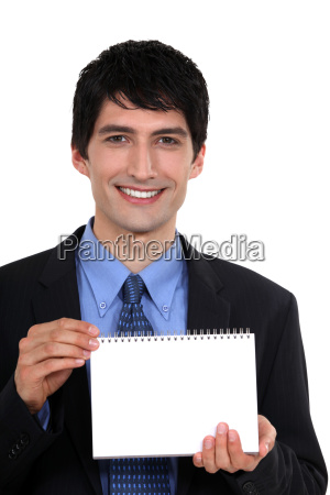 man showing blank page on a
