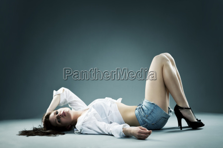 young beautiful woman on the floor