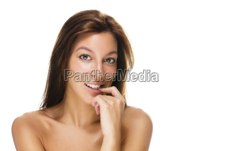 beautiful woman with fingertip on mouth