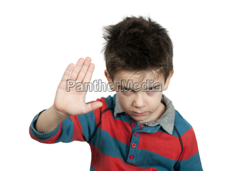 little boy showing stop with his