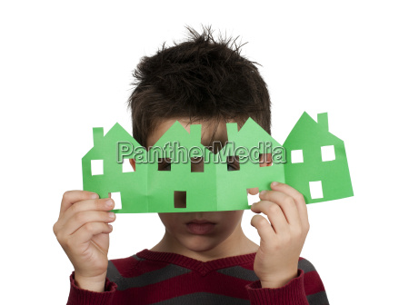 little boy holding houses made of