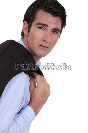 businessman with his jacket over his