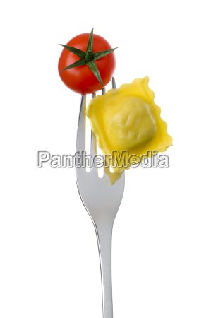 ravioli and tomato on a fork