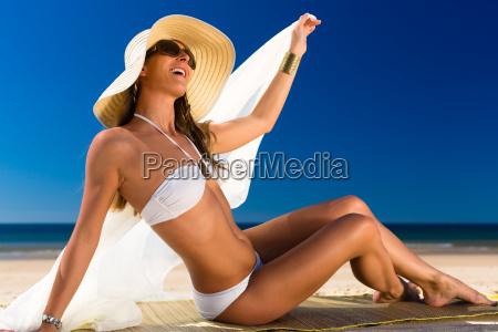 attractive woman in bikini sitting in