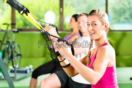 fitness people in suspension training