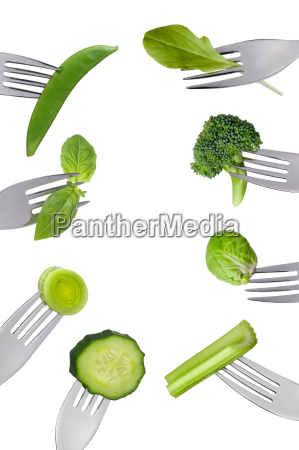 border of fresh green vegetables isolated