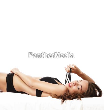 beautiful sensual woman is lying on